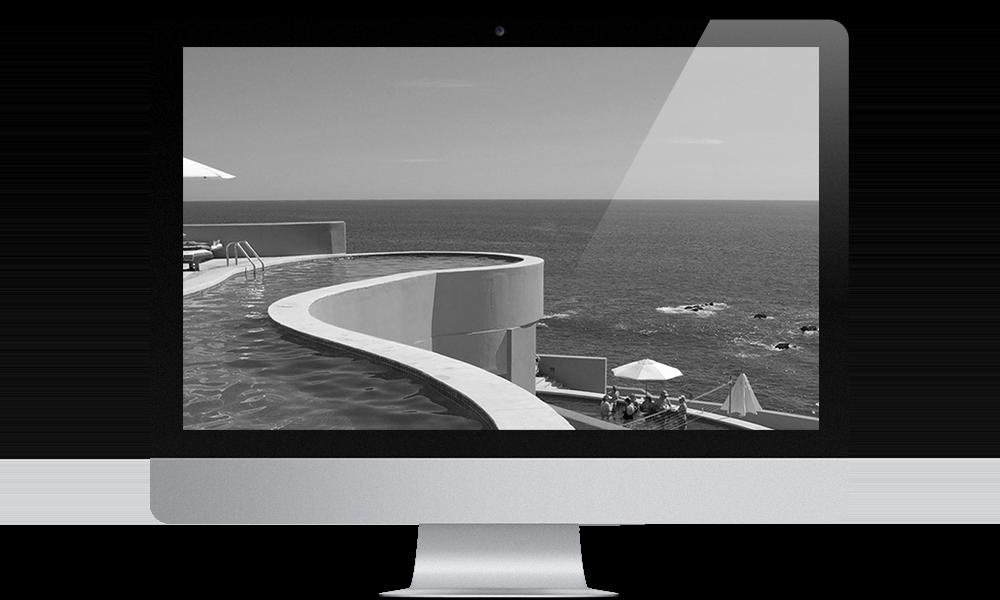 Mac with image of pool overlooking ocean