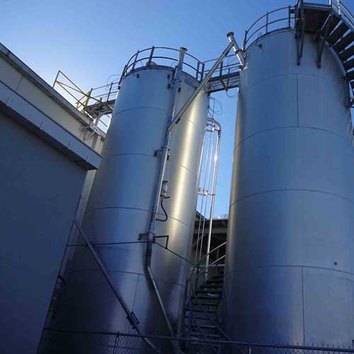 Two Large Storage Silos with Staircase