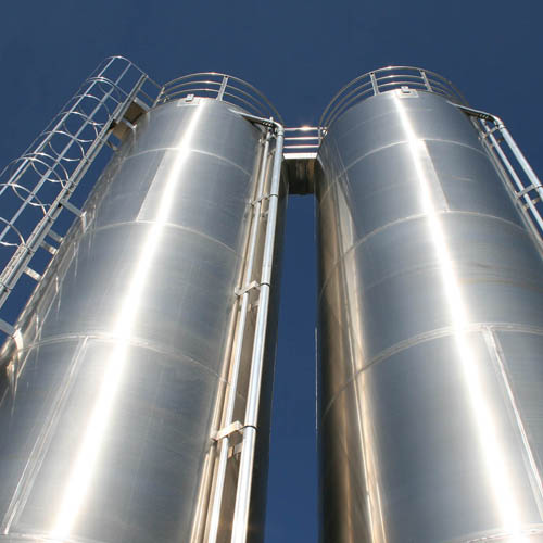 Looking up at Two Steel Storage Silos