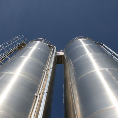 Looking up at Two Storage Silos