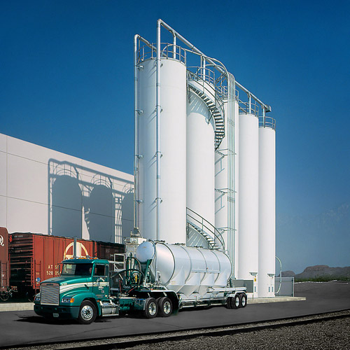 Truck and Four Silos Outside